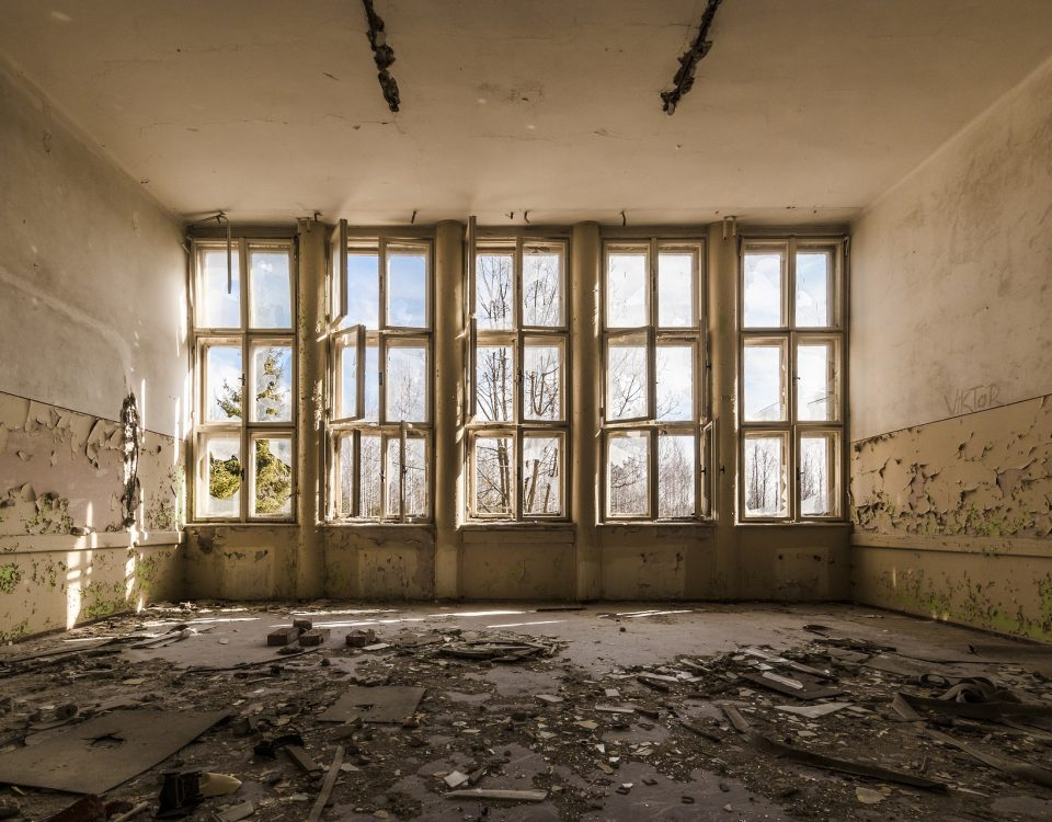 Empty room in an abandoned building, shards everywhere